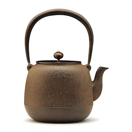 枣形素文铁壶(铜盖 )